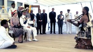 The Queen and the Duke of Edinburgh are entertained by Fijian musicians and traditional dancers in 1977