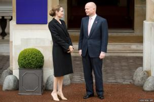 Angelina Jolie is greeted by British Foreign Minister William Hague outside Lancaster House in central London