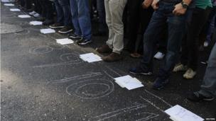 Venezuelans line up in numbered rows to vote