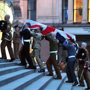 The bearer party carry a coffin up the steps of St Paul's Cathedral in central London during a rehearsal for the ceremonial funeral of Baroness Thatcher Margaret Thatcher