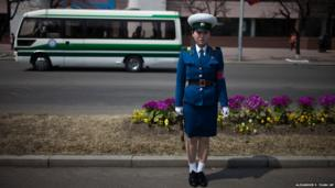 A traffic policewoman stands on a street in Pyongyang, North Korea
