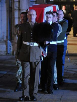 The bearer party, from the three military services, carry a coffin outside St Clement Danes church during a rehearsal for the ceremonial funeral of former British PM Margaret Thatcher.