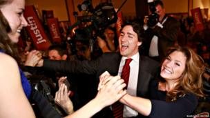 Candidate Justin Trudeau and his wife Sophie Gregoire (right) arrive for the Liberal Party of Canada leadership vote