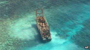 A Chinese fishing vessel is stranded after it ran aground at the Tubbataha reef in the Sulu Sea, Palawan province, 10 April 10 2013