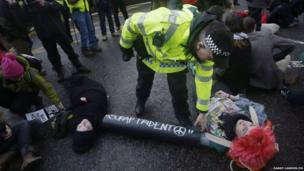 Anti-nuclear protesters stage a blockade at the Faslane naval base on the Clyde