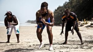 From left to right, Aissatou Diba, 20, Sirefina Diediou, 19 and Aminata Diatta, 16, training on a beach in the village of Diembering, Casamance.