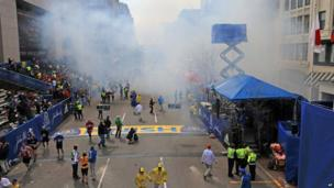 The finish line of the Boston Marathon shrouded in smoke, 15 April 2013