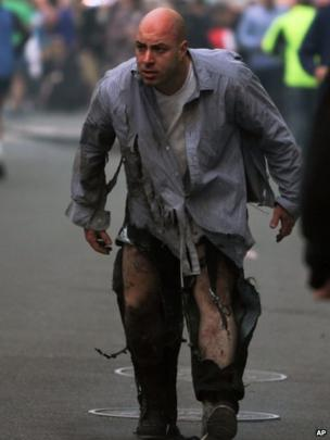 A man walks away with minor injuries from the Boston marathon bombings, 15 April 2013