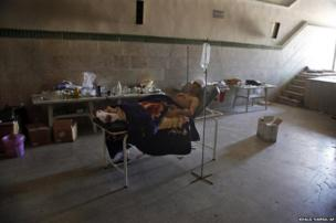 Mahmoud, a 21-year-old Palestinian resident of Syria who would only give his first name, rests in a field hospital 6 August, 2012