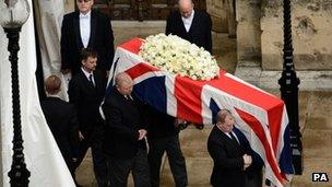 Lady Thatcher's coffin is carried by pallbearers
