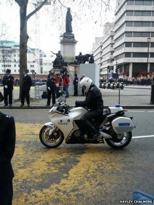 Police rider at the back of the cortege. Photo: Hayley Chalmers