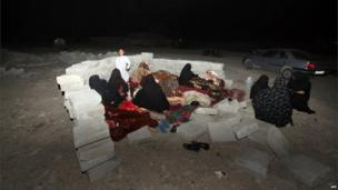 Iranian residents take shelter in a field after an earthquake hit south-eastern Iran, 16 April 2013