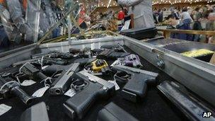 file photo of handguns on display at the table of David Petronis of Mechanicville, New York 26 January 2013