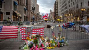 Flowers and flags left following the Boston Marathon bombing. Photo: Youvathana Sok