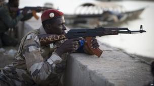 A Malian soldier pointing his gun in Gao, Mali - Saturday 13 April 2013