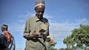 A Somalia man with bundles of money in Mogadishu, Somalia - Saturday 13 April 2013
