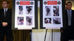 FBI Agents with images of the two suspects