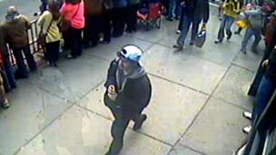 Suspect in white cap in Boston bombing