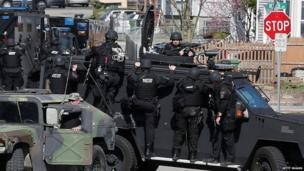 Members of a SWAT team search for 19-year-old bombing suspect Dzhokhar A. Tsarnaev on April 19, 2013 in Watertown, Massachusetts