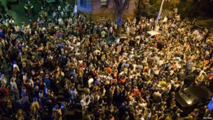 Hundreds of people celebrate in Boston after the capture of Dzhokhar Tsarnaev, 19 Apr
