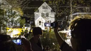 Neighbours use cameras to record images of the boat in Franklin St where Boston Marathon suspect Dzhokhar Tsarnaev had been hiding.