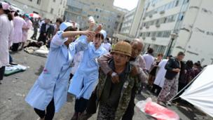 Injured people receive medical treatment at the People's Hospital after a strong magnitude earthquake hit Lushan county, Sichuan province
