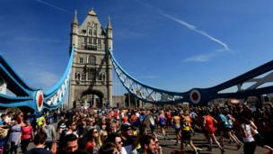 Runners taking part in the 2013 London Marathon in southeast London on April 21, 2013