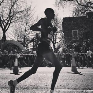 A runner runs by Tower Bridge. Photo: Luke Rogers