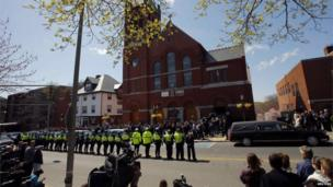 Policemen, friends and family of Krystle Campbell line the street outside St Joseph Church, 22 April