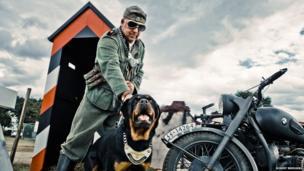 World War II re-enactment featuring a German guard