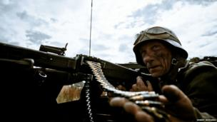 WWII re-enactment featuring a German gunner