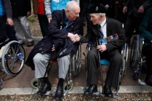 Korean War veterans shake hands at a ceremony at the Gloster Hill Memorial, near the demilitarized zone separating the two Koreas, in Paju