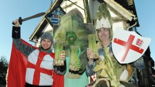 Three men dressed as St. George and some asparagus