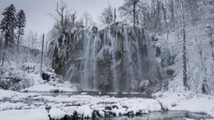 Winter in Plitvice lakes national park, a UNESCO World Heritage Site, Croatia. Waters flowing over limestone and chalk over thousands of years have created natural dams which in turn have produced a series of beautiful lakes, caves and waterfalls.