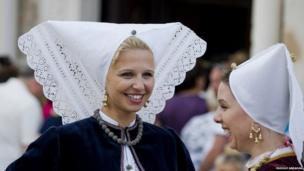 Croatian women in traditional local folk costume, during a procession on Assumption Day on the island of Pag. Following an all night vigil, a statue of the Virgin Mary is carried from a shrine in the old town to the Church of the Assumption of the Virgin Mary in the town centre.