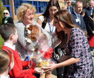 The Duchess of Cambridge receives flowers and treats