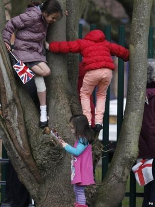 Girls climbed a tree to get a better view of the Duchess