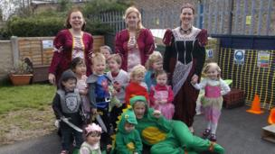 Children and staff at Little Acorns nursery dressed as dragons, knights and princesses