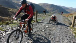 Karen Darke rides on a stony part of the bridleway
