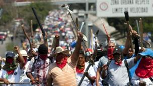 Teachers march on the main highway between Mexico City and Acapulco on 18 April 2013