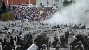 Federal police and teachers clash during a protest in April 2013