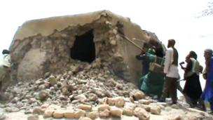 A still from a video shows Islamist militants destroying an ancient shrine in Timbuktu on 1 July 2012