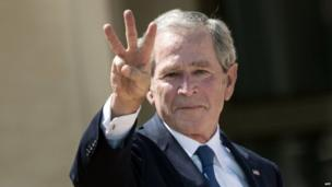 """Former President George W Bush flashes a """"W"""" sign at the opening of the George W Bush Library in Dallas, Texas (25 April 2013)"""