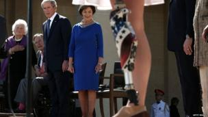 The first female Army veteran to lose a limb in the War in Iraq recites the pledge of allegiance at the opening of the George W Bush Library in Dallas, Texas (25 April 2013)