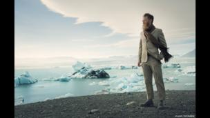 Man standing on glacier in Iceland