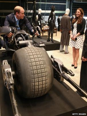 Prince William, Duke of Cambridge sits on the Batpod during the Inauguration Of Warner Bros.