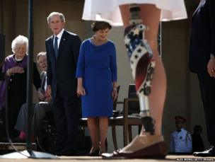 Melissa Stockwell reads the pledge of allegiance to America watched by former Presidents George HW and George W Bush and their wives, Barbara and Laura