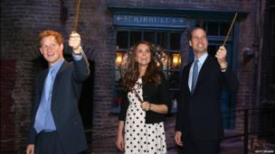 Harry, Kate and William raise their wands on Diagon Alley