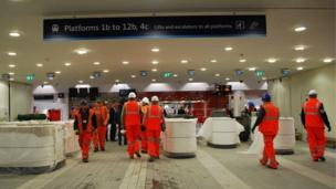 Builders at work in the new concourse at New Street station