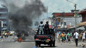 Police on a truck following a post-election protest in in Koumassi, Abidan, Ivory Coast - Monday 22 April 2013